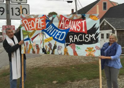 UUC against racism banner